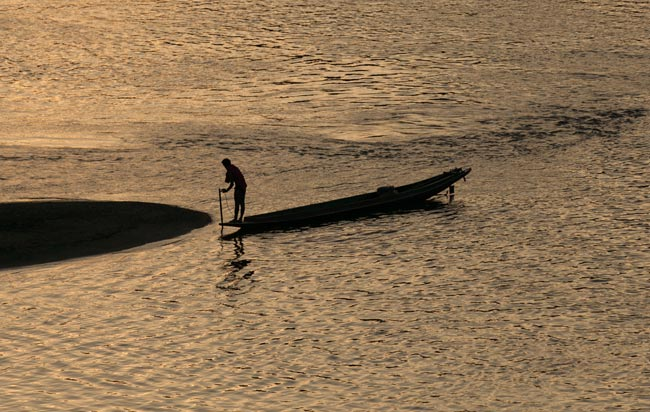 A fisherman at sunset from the bridge