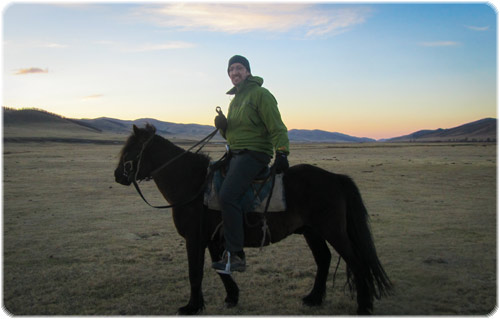 Smug Stu in the back of beyond on a rather small looking horse - Mongolia