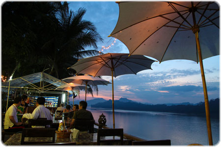 Watching a beautiful sunset over the Mekong River in one of Luang Prabang's many riverside restaurants