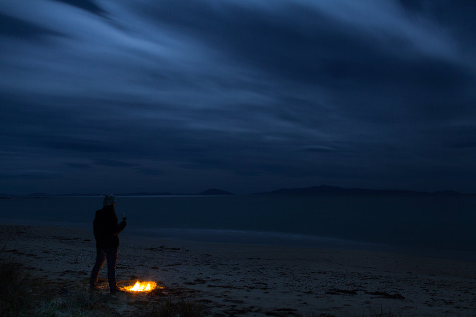 camping by the fire in Tasmania