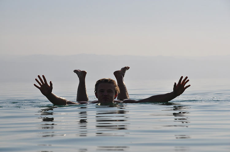 woman floating dead sea