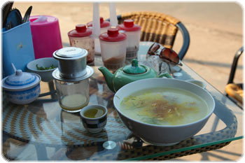 Vietnamese breakfast of 'Jow' - rice soup with chicken (I think) and coffee!