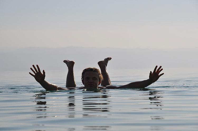 woman floating dead sea